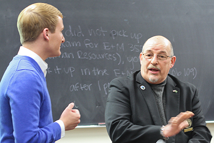 Casey Hoffman, '12, and Albion Mayor Joe Domingo talk at a recent class meeting.