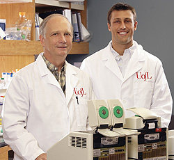 Dr. Keith Davis, '79, executive director of the OCRP, and Matt Lozier in the lab.