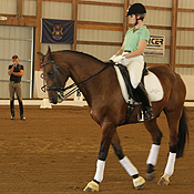 Held Equestrian Center Marketing Coordinator Randi Heathman performs a walk pirouette with Ricochet while Steffen Peters provides instruction.