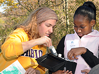 Abby Williams, '12, works with a student from the University Prepatory Academy