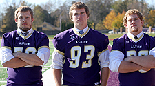 Jason Bajas, Jacob Heinrich, and C.J. Carroll are economics & management majors with an emphasis in accounting. Carroll and Heinrich rank among the MIAA leaders in tackles for loss and sacks. Photograph by Dave Lawrence, Albion College Communications.