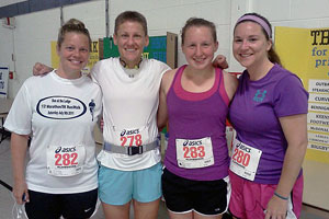 Baker, history professor Marcy Sacks, Dobbins and Lizzy Thornton, '09, at the 2011 Grand Ledge half marathon.