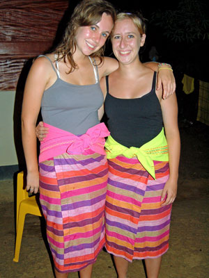 Kirsch and Kaisler in traditional Surinamese skirts