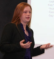 Katie Blumberg gestures while making her final presentation in class.