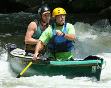 Scott Dillery, '83, and Zaak Havens, '10, paddle the Nantahala River.