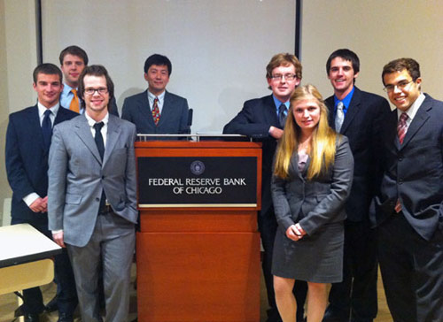 "Albion's ""Fed Challenge"" team: Evan Malecke, Kurt Tech, Michael Davis, adviser Kotaro Yoshida, John Rogers, Heather Waldron, Thomas Worden, Andy Bieber."