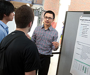 Daniel Dai, '14, one of 11 Albion students who participated in the Google Marketing Challenge, explained his team's project to poster session audiences.
