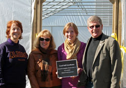President Donna Randall, Linda, Rich and Jessie Baird at the Good Soil Growhouse dedication
