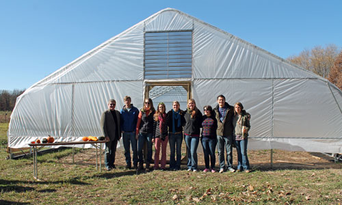 Albion College Student Farm members at the dedication of the Good Soil Growhouse