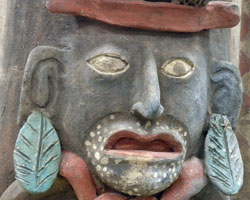 A Mayan 'Earth Lord' depicted on a clay incense burner used in religious observances. The pot was made and used around 1500 CE and was collected from a sacred cave in the Maya region in Mexico by Albion alumnus Marvin Vann, '40. The pot is part of Albion College's Vann collection of pre- and post-Columbian artifacts and ethnographic research.