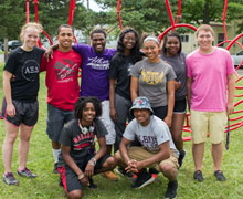 Build Albion Fellows (BAF) members and staff at the Holland Park Playground build:  BAF mentor Maddie Drury, '15; Demarcus Robinson, '19; BAF rtrainer Carles Sommerour, '16; Dominique Givens, '19; Mercedes Pace, '19;  Khaliah Roberts, '19; Robert Hays, '19. Front: Cortazia Wilson, '19;  Markeese Boyd, '19.