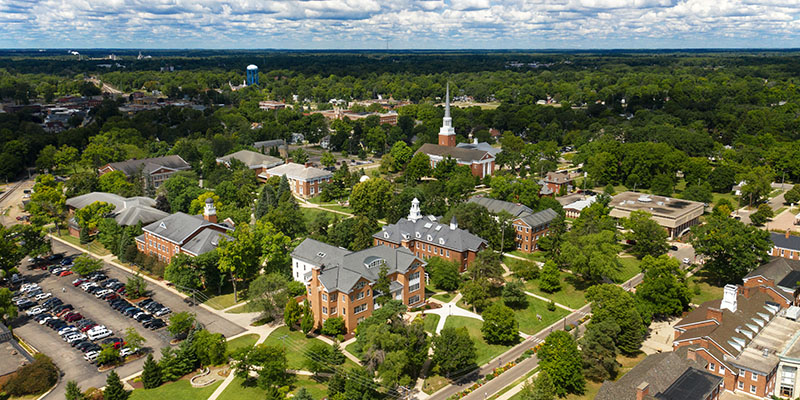 A drone view of the Albion College campus with the community of Albion, Michigan, in the background.