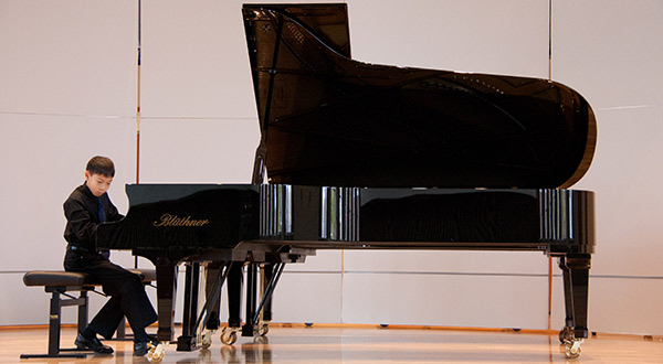 A student performs during the 2013 Albion College Piano Festival.