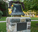 Albion College bell outside the east entrance of Robinson Hall.