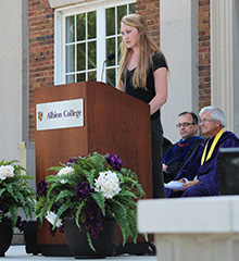 First-year student Briana Flanagan of Harrisburg, South Dakota, recites the Student Pledge during the August 21 matriculation ceremony on the steps of Kresge Gymnasium. Pictured behind Briana are Provost Marc Roy and President Mauri Ditzler.