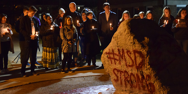 Albion College students, faculty and staff gathered for a candlelight vigil at The Rock on the campus quadrangle, February 27, 2018.