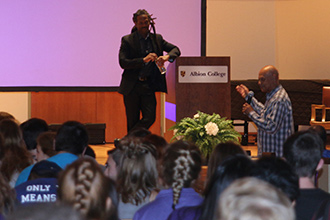 Following his presentation, Dr. Carl Hart (on stage) listens to a question from audience member Dr. James Curtis, '44.