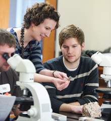 Geology professor Carrie Menold works with a student in the lab.