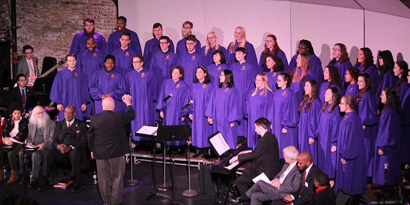 The Albion College Concert Choir, conducted by professor of music Clayton Parr, '80, perform January 29 during the 2018 Reverend Dr. Martin Luther King, Jr. Convocation and Community Celebration at the Bohm Theatre.