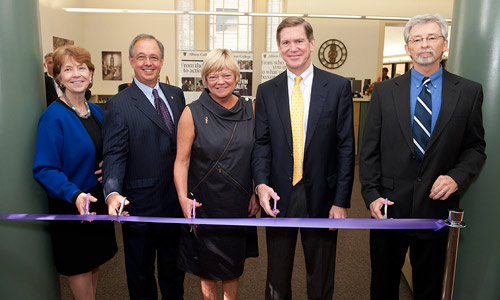 Cutting the ribbon on Stockwell Library's new Cutler Commons: President Donna Randall; Board of Trustees Chairman Paul Tobias, '73; Sally Stark Cutler, '75; Sandy Cutler; Library Co-Director Mike Van Houten.