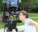 Viewing the August 21, 2017 solar eclipse through a telescope on the Albion College Quadrangle.