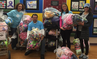 Morgan Garmo (second from right) with Fleece & Thank You volunteers at Mercy Children's Hospital.