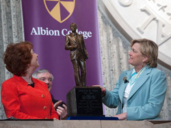 Albion College President Donna Randall and Susan Ford Bales unveil the President Ford maquette.