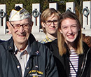Pearl Harbor survivor Cal Calderone at the World War II Memorial in Washington, D.C., with students in Dr. Wes Dick's First-Year Seminar titled Albion & the American Dream.