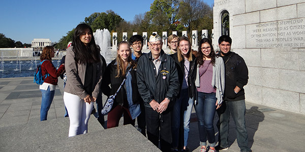 "Students in Dr. Wes Dick's Albion and the American Dream First-Year Seminar met Pearl Harbor survivor Adone ""Cal"" Calderone at the World War II Memorial during a visit to Washington, D.C. in November."