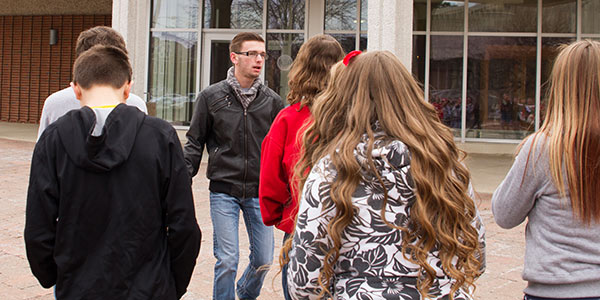Admission tour guide Branden Miller, '17, talks with Jackson eighth graders as they head into the Science Complex.