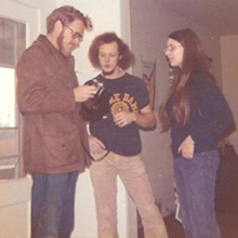 Dr. Johan Stohl with Bill Minnich, '72, and Meg (Dawe) Minnich, '74, inside 1213 E. Erie St. in 1973. All were involved in the Fall 1973 student-created, living-learning course officially titled Religious Studies 381: Values and Value Theory.