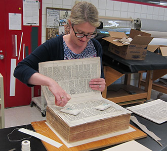 University of Michigan conservator Marieka Kaye spent nearly two years over nights and weekends restoring Albion College's first-edition King James Bible, page by page.