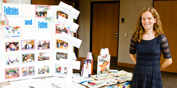 An Albion College student presents her portfolio during the 2013 Maymester Showcase.