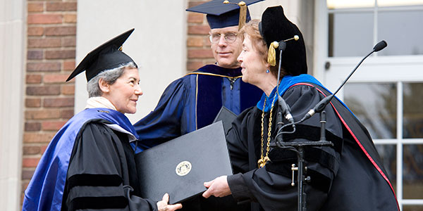 Miriam Winter, history professor Geoffrey Cocks, and President Donna Randall at 2009 Commencement.