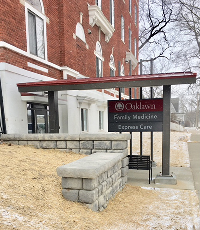 The Oaklawn Express Care - Albion entrance on Monroe Street, at Munger Place. This view of the entrance looks south toward Michigan Avenue.