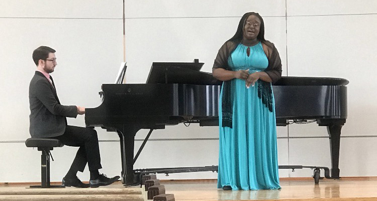 Pem Ogundare, '20, performs during her junior recital last month, accompanied on piano by Nicholas Laban, '11.