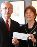 State Farm agent Mark Putvin and Albion College President Donna Randall.