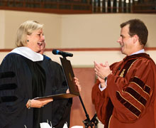 Interim President Mike Frandsen greets Susan Ford Bales following the conferral of an honorary doctorate.