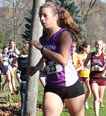Accounting major Theresa Hencsie, '16, competes for the Albion women's cross country team.