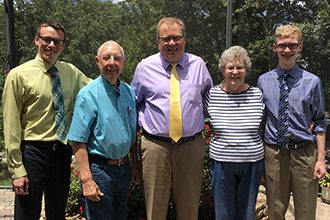 From left: Beau Brockett, '19; Richard Vitek, '56; Bob Anderson, vice president for alumni relations and development; Marilyn Young Vitek, '56; Kody Smith, '20.