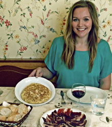 Emily Walker with some of her favorite dishes, cooked by her host mother