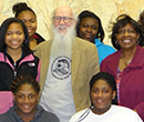 Albion College Professor of History Wes Dick (center) with Albion Community School students and members of Sisters Influencing Society, a local mentoring group.