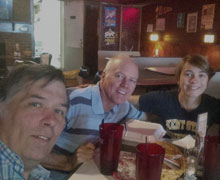 Seely, mathematics professor Paul Anderson, and Leanne Wegley, '18, in Albion's Charlie's Tavern
