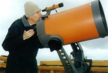 One of Albion College's Celestron telescopes being used from the top of Palenske Hall.