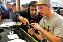 Albion College physics students in the lab.