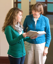 Associate professor Jocelyn McWhirter helps a student.
