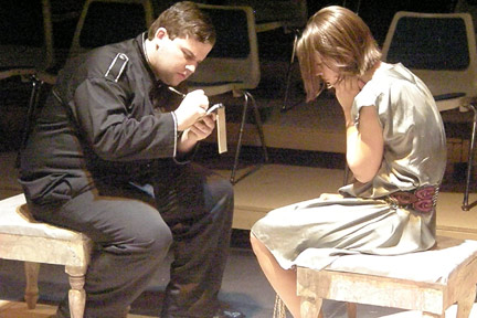 Ryan Fisher and Callie Bussell in a scene from the Fall 2011 production of Antigone by Jean Anouilh.