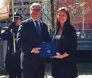 Rebekah Snyder. '14, receives an award from Rhode Island attorney general Peter Kilmartin.