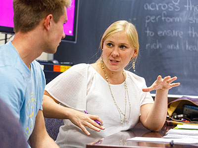 An Albion College student (left) and professor have a conversation.
